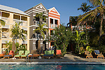 Grand Bahama Island, The Bahamas; colorful architecture on the hotel room buildings exterior surrounding the Sabor Pool at the Pelican Bay Hotel