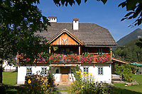 Austria, Styrian Salzkammergut, Grundlsee: flower decorated cottage