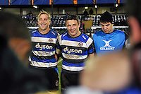 Sam Burgess of Bath Rugby is all smiles in a post-match huddle. European Rugby Champions Cup match, between Bath Rugby and Montpellier on December 12, 2014 at the Recreation Ground in Bath, England. Photo by: Patrick Khachfe / Onside Images