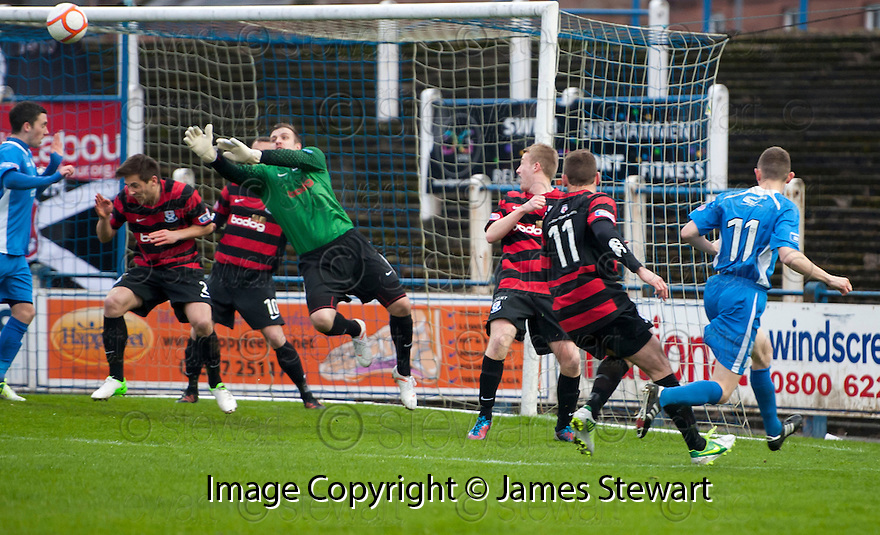 Ayr Utd Goalkeeper Ally Brown saves from Queen of the South's Paul Burns.
