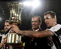 Football Soccer - Juventus - Lazio - Italian Cup Final - Olympic Stadium, Rome, Italy, May17,2017.<br /> Juventus' coach Massimiliano Allegri (c) Miralem Pjanic (l) and Mario Mandzukic (d) celebrate with the trophy after winning the Italian Cup Final match at Rome's Olympic stadium, on May 17, 2017.<br /> UPDATE IMAGES PRESS/Isabella Bonotto