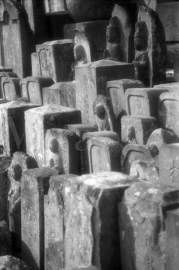 Detail of centuries-old gravestones, Japan