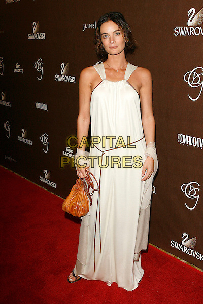 GABRIELLE ANWAR.The 10th Annual Costume Designers Guild Awards held at the Beverly Wilshire Hotel, Beverly Hills, California, USA..February 19th, 2008.full length white dress cream rope belt bag purse brown .CAP/ADM/ZL.© Zach Lipp/AdMedia/Capital Pictures.