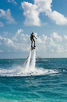 Maldives, Rangali Island. Conrad Hilton Resort. Man on jet blade.