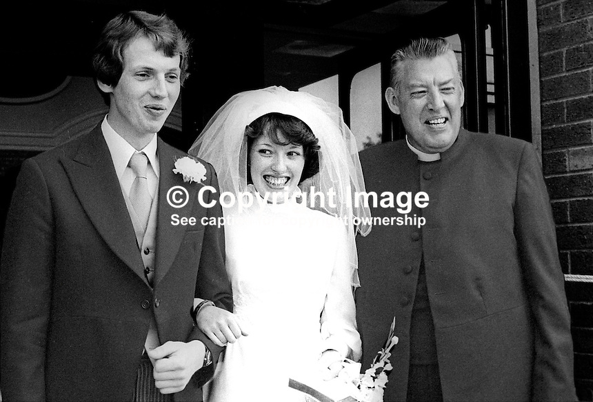 Rev Ian Paisley with his daughter, Sharon, and her husband, John Huddleston, after their wedding in Martyrs Memorial Free Presbyterian Church, Belfast, N Ireland, 7th July 1977, at which he officiated. 197707000153b.<br />