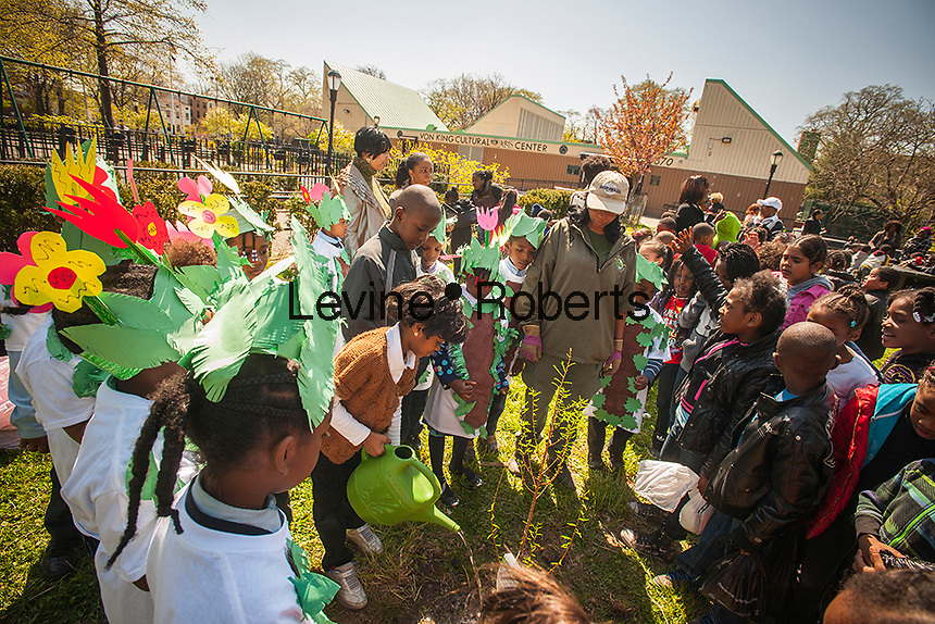 First and second graders from neighborhood schools celebrate Arbor Day in Herbert Von King Park in the Bedford-Stuyvesant neighborhood of Brooklyn in New York on Friday, April 26, 2013. The students planted trees,  played recycling games and learned about the importance of trees in keeping the air we breathe clean. (© Richard B. Levine)