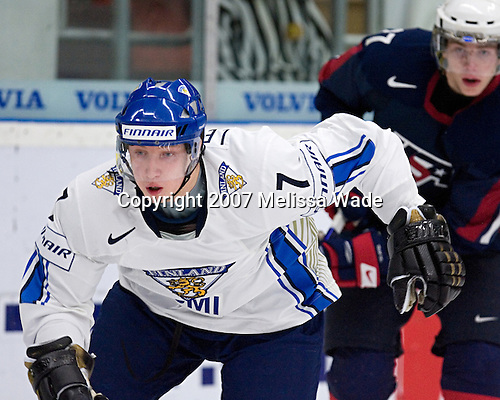Tommi Leinonen (Kajaani, Finland - Karpat Oulu) reaches for the puck. Team USA defeated Team Finland 6-3 in a 2007 World Juniors quarterfinal matchup on Tuesday, January 2, 2007 at FM Matsson Arena in Mora, Sweden.