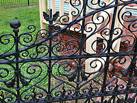 An iron gate guards the entrance to a porch on a house in Billie Creek Village, a restoration of early settlement in Indiana, Rockville, Indiana