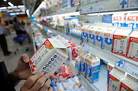 Chinese customer buying dairy products at a Wu Mart supermarket in Beijing, China.  Wu Mart, the Beijing-based chain, was founded in the early 1990s by Zhang Wenzhong. Its name smacks of the fame of U.S. retail giant Wal-Mart. Wu Mart and Wal-Mart are competing in different arenas and each appears to be going after a different class of consumer. By 2005, Wu Mart had more than 450 hypermarkets, supermarkets and convenience stores, and is one of only a few Chinese retailers whose shares are publicly traded..28 May 2011