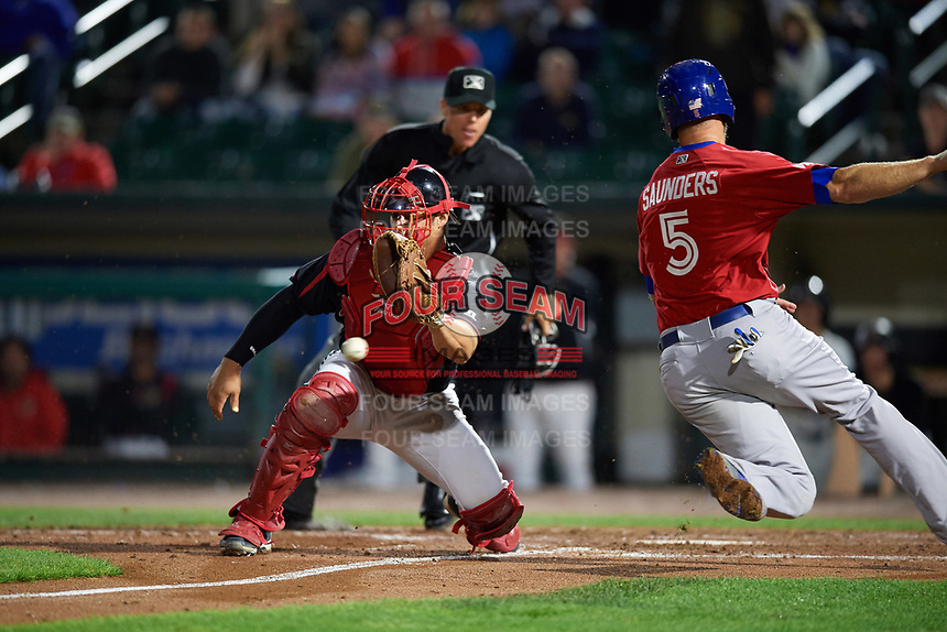 Rochester Red Wings catcher Anthony Recker (30) attempts to catch a throw as Michael Saunders (5) scores the go ahead run in the top of the eleventh inning as umpire Chris Graham looks on during a game against the Buffalo Bisons on August 25, 2017 at Frontier Field in Rochester, New York.  Buffalo defeated Rochester 2-1 in eleven innings.  (Mike Janes/Four Seam Images)