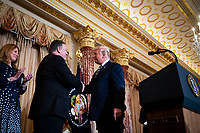 United States President Donald J. Trump greets Mike Pompeo, U.S. secretary of state, before he is sworn in, as his wife, Susan Pomepo, looks on, at the State Department, in Washington, D.C., U.S., on Wednesday, May 2, 2018. <br /> Credit: Al Drago / Pool via CNP /MediaPunch