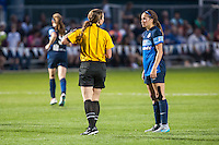 Kansas City, Mo. - Saturday April 23, 2016: FC Kansas City forward Shea Groom (2) argues with a ref after receiving a yellow card during a match against the Portland Thorns FC at Swope Soccer Village. The match ended in a 1-1 draw.