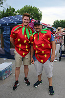 MEGAN DAVIS/MCDONALD COUNTY PRESS Despite there being no Little Mister Strawberry Pageant, Levi Stone and Gary Wasson dawned strawberry costumes and filtered through the crowd, entertaining spectators.