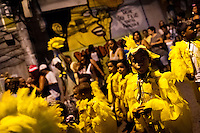 Brazilian children, wearing yellow bird costumes, take part in the Carnival parade in the favela of Rocinha, Rio de Janeiro, Brazil, 20 February 2012. Rocinha, the largest shanty town in Brazil and one of the most developed in Latin America, has its own samba school called GRES Academicos da Rocinha. The Rocinha samba school is very loyal to its neighborhood. Throughout the year, the entire community actively participate in rehearsals, culture events and parades related to the carnival.
