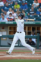 Zack Collins (8) of the Charlotte Knights follows through on his swing against the Buffalo Bisons at BB&T BallPark on July 24, 2019 in Charlotte, North Carolina. The Bisons defeated the Knights 8-4. (Brian Westerholt/Four Seam Images)
