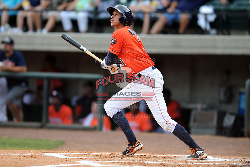 Greenville Astros designated hitter Edwin Gomez #1 swings at a pitch during a game against the Kingsport Mets at Pioneer Park on August 4, 2013 in Greenville, Tennessee. The Astros won the game 17-1. (Tony Farlow/Four Seam Images)