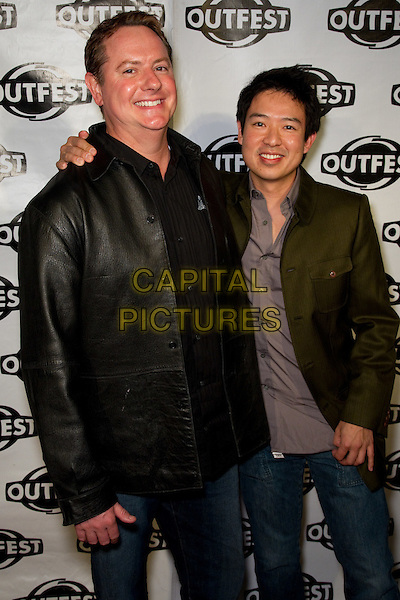 JONATHAN FRANKLIN, QUENTIN LEE.Arrivals to a Screening of The People I've Slept With, presented by Outfest as part of Fusion: the Los Angeles LGBT People of Color Film Festival, Hollywood, CA, USA, March 13th, 2010. .half length green jeans jacket black leather smiling arm around .CAP/CEL .©CelPh/Capital Pictures