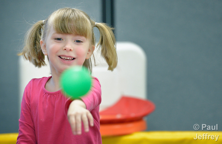 Four-year old Karis Andrews throws a ball in the sensory-motor playroom at University United Methodist Church in San Antonio, Texas. The room is part of the congregation's special needs ministries, and is open to the community, providing access to therapeutic toys and equipment at no cost to children with developmental delays.
