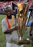 July 24, 2005: East Rutherford, NJ, USA:  USMNT forward DaMarcus Beasley (7) shows off the trophy after winning the CONCACAF Gold Cup at Giants Stadium.  The USMNT won 3-1 on penalty kicks.