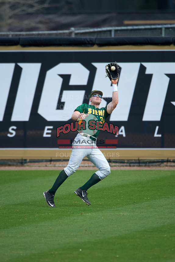 Siena Saints right fielder Fred Smart (32) catches a fly ball during a game against the UCF Knights on February 21, 2016 at Jay Bergman Field in Orlando, Florida.  UCF defeated Siena 11-2.  (Mike Janes/Four Seam Images)