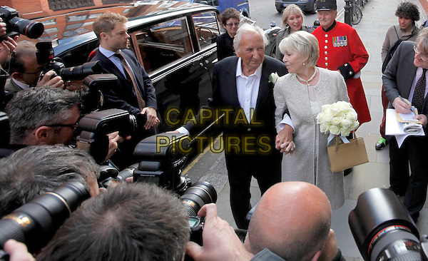 Michael Winner & Geraldine Lynton-Edwards .The wedding of Michael Winner & Geraldine Lynton-Edwards at Chelsea Registry Office in London, England..19th September 2011.married husband wife marriage full length white dress black suit holding hands grey gray bouquet flowers paparazzi photographers press.CAP/CAM.©Andre Camara/Capital Pictures.