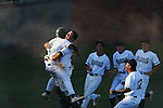 Flagler Palm Coast's Mark Jones (2) get's a hug from Jesse Piccolo (23) after scoring the game winning run in extra innings Tuesday, April 24, 2007, at Melching Field at Conrad Park in DeLand. Flagler Palm Coast was playing Spruce Creek in the semifinal of district 2-6A baseball. (Daytona Beach News-Journal, Chad Pilster) .**ALSO FOR PCN**