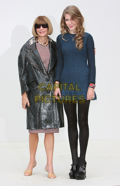 Anna Wintour & Ellie Wintour .Burberry Prorsum S/S Show Arrivals at Kensington Gardens, London, England..September 19th 2011.LFW full length mother mom mum daughter family sunglasses shades black grey gray leather mac blue dress tights tall short wool red stripe.CAP/ROS.©Steve Ross/Capital Pictures