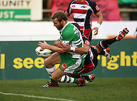 Manawatu fullback Casey Stone scores in the tackle of Siale Piutau during the Air NZ Cup rugby match between Manawatu Turbos and Counties-Manukau Steelers at FMG Stadium, Palmerston North, New Zealand on Sunday, 2 August 2009. Photo: Dave Lintott / lintottphoto.co.nz