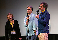 """AUSTIN, TX- MARCH 8: Taika Waititi, left, and Jemaine Clement speak during the SXSW world premiere of FX's """"What We Do in the Shadows"""" at the Paramount Theater on March 8, 2019 in Austin, Texas. (Photo by Stephen Spillman/FX/PictureGroup)"""