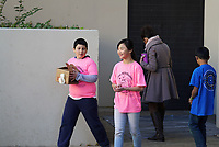 "(Photo by Allen Li, Occidental College class of 2020)<br /> 10:30am - ""Egg Drop"", Library entrance patio. Students must build a device that will cradle a raw egg so that it will hit a target on the ground when dropped off the wall, but not crack.<br /> <br /> Individual competition events at the 24th Annual Los Angeles County Elementary Science Olympiad Saturday, February 24, 2018 at Occidental College."