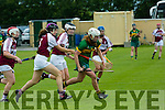 Kerry's  Patrice Diggin gets away from Westmeath's Aoife Higgins   at the Kerry v Westmeath Camogie match at Abbeydorney GAA field on Sunday