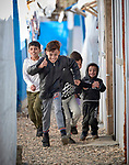 Yazidi children run between shelters in a camp for internally displaced persons at Dawodiya in Iraq's Kurdistan region. More than 600 Yazidi families living in the camp escaped from their communities in the Sinjar region during the attempted genocide by the Islamic State group. Although ISIS was militarily defeated in 2017, camp residents say it's still not safe to return home, nor do they have sufficient resources to rebuild their homes.<br /> <br /> The Lutheran World Federation, a member of the ACT Alliance, provides water, sanitation, garbage collection, and psycho-social support for the families in the camp.