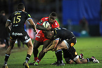 Josua Tuisova of RC Toulon forces his way through the tackle of Chris Cook of Bath Rugby during the European Rugby Champions Cup match between Bath Rugby and RC Toulon - 23/01/2016 - The Recreation Ground, Bath Mandatory Credit: Rob Munro/Stewart Communications