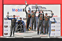 #77 Compass Racing, Audi RS3 LMS TCR, TCR: Britt Casey Jr, Tom Long celebrates the win on the podium #54 JDC-Miller MotorSports, Audi RS3 LMS TCR, TCR: Michael Johnson, Stephen Simpson, #75 SunEnergy1 Racing Mercedes AMG GT3, GTD: Kenny Habul, Mikael Grenier