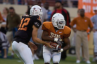01 APRIL 2006: University of Texas freshman quarterback hopeful, Colt McCoy (left), hands off the ball to running back Jamaal Charles at Darrell K. Royal Memorial Stadium during the Longhorns annual spring Orange vs White Scrimmage.