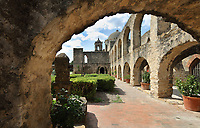 Church and convent courtyard arcade at the Mission San Jose, or Mission San Jose y San Miguel de Aguayo, a Spanish catholic colonial mission and church originally established in 1720 and completed in 1782, to spread Christianity among Native Americans, the largest of 4 missions in the San Antonio Missions National Historical Park, in San Antonio, Texas, USA. The complex was home to 350 Indians and had its own mill and granary. It was restored in the 1930s and again in 2011. It forms part of the San Antonio Missions UNESCO World Heritage Site. Picture by Manuel Cohen