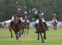 Apichet Srivaddhanaprabha (King Power) and Nick Clarke (Salkeld) battle for the ball during the Cartier Queens Cup Final match between King Power Foxes and Dubai Polo Team at the Guards Polo Club, Smith's Lawn, Windsor, England on 14 June 2015. Photo by Andy Rowland.