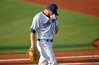 Charlotte Stone Crabs starting pitcher Brendan McKay (31) wipes sweat off his face as he walks to the dugout in between innings during a game against the Dunedin Blue Jays on June 5, 2018 at Charlotte Sports Park in Port Charlotte, Florida.  Dunedin defeated Charlotte 9-5.  (Mike Janes/Four Seam Images)