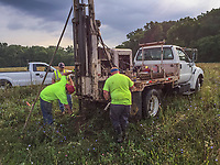 Engineers drills holes to collect soil core samples from lowland farm land near Alum Creek in Westerville, Ohio, where planners hope to build a multi-use development on farm land.