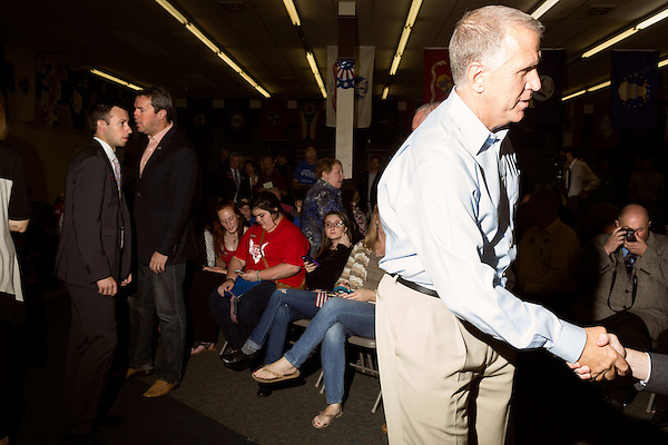 September 20, 2014. Greensboro, North Carolina.<br />  US Senate candidate Thom Tillis, 2nd from right, greeted rally attendees as he arrived.<br />  Thom Tillis and Mark Walker hosted a rally at the Guilford County Republican Party headquarters for their supporters in the upcoming November election. Tillis, the current Speaker of the House for the NC House of Representatives, is running to take Democrat Kay Hagan's US Senate seat, while Walker, a local pastor, is running for the NC 6th District' s US Congressional seat.