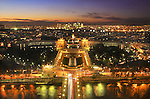 France, Paris.  <br /> Just after sunset is the best time to take a low light or night photo of Paris from the Eiffel Tower. There is still color in the sky and the city light are all the way on. Soon the sky will turn black.