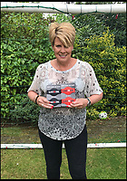 BNPS.co.uk (01202 558833)<br /> Pic: Laceeze/BNPS<br /> <br /> Paula Henley with Laceeze.<br /> <br /> A children's soccer coach has invented a solution that stops laces coming undone after getting frustrated by games being stopped so a player could have theirs tied up.<br /> <br /> Paula Henley, who runs an under 9s football team, had a lightbulb moment when a child turned up for training with a rubber band wrapped around each boot which held his laces in place.<br /> <br /> Mrs Henley, who like many football coaches and parents across Britain regularly has to run onto the pitch to fasten a child's errant laces, went away to develop a foolproof design that appealed to children - and came up with Laceeze.<br /> <br /> The product is a robust but brightly-coloured silicone strap that fits over any boot or trainer and has an enlarged centre section which totally covers the laces.