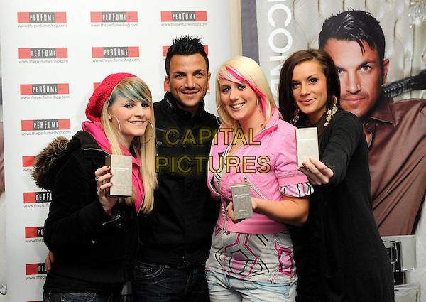 "PETER ANDRE & FANS .Attends a signing for ""Unconditional"" the now number one best selling fragrance at Bluewater Shopping Centre, Kent..10th December 2009..half length black jacket girls posing .CAP/DH.©David Hitchens/Capital Pictures."