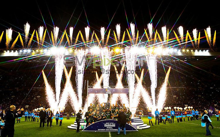 Picture by Alex Whitehead/SWpix.com - 30/11/2013 - Rugby League - Rugby League World Cup Final - New Zealand v Australia - Old Trafford, Manchester, England - Australia celebrate with the trophy.