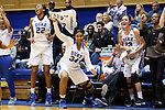 07 January 2016: Duke's Lynee Belton (34), Oderah Chidom (22), and Crystal Primm (13) cheer for their teammates. The Duke University Blue Devils hosted the Wake Forest University Demon Deacons at Cameron Indoor Stadium in Durham, North Carolina in a 2015-16 NCAA Division I Women's Basketball game. Duke won the game 95-68.
