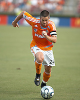 Houston Dynamo defender Wade Barrett (24) dribbles the ball. Houston Dynamo beat FC Dallas 2-1 at Robertson Stadium in Houston, TX on June 3, 2007.