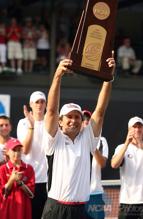 22 MAY 2007:  Head Coach Manuel Diaz of the University of Georgia shows off his teams' trophy after defeating the University of Illinois during the Division I Men's Tennis Championship held at the Dan Magill Tennis Complex on the University of Georgia campus in Athens, GA.  Jamie Schwaberow/NCAA Photos