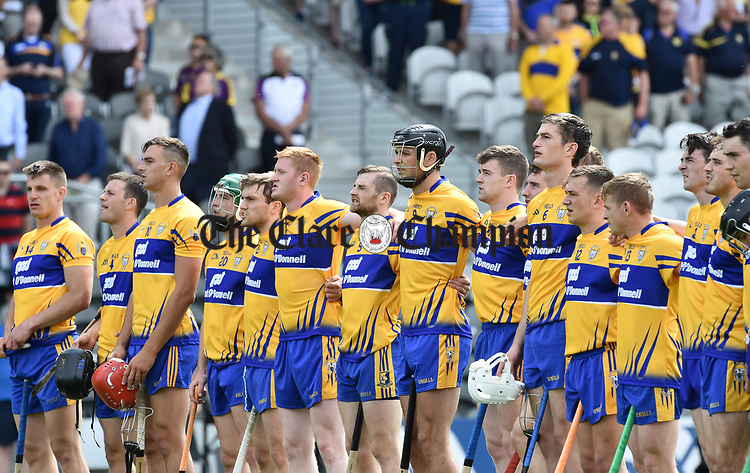 Clare stand for the anthem before their All-Ireland quarter final against Wexford at Pairc Ui Chaoimh. Photograph by John Kelly.