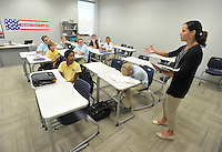 NWA Democrat-Gazette/MICHAEL WOODS &bull; @NWAMICHAELW<br /> Haas Hall Academy teacher Anjanette Levings talks with her students during a class activity Friday August 7, 2015, at the new Bentonville campus.  Classes at the new Bentonville campus started Thursday.