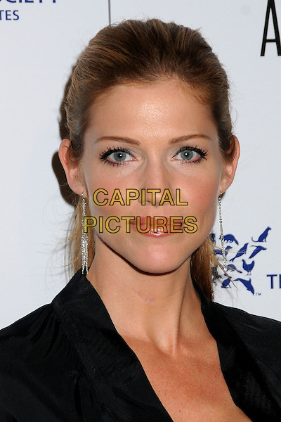 TRICIA HELFER .24th Annual Genesis Awards - Arrivals held at the Beverly Hilton Hotel, Beverly Hills, California, USA, 20th March 2010..portrait headshot black hair up dangly earrings .CAP/ADM/BP.©Byron Purvis/AdMedia/Capital Pictures.